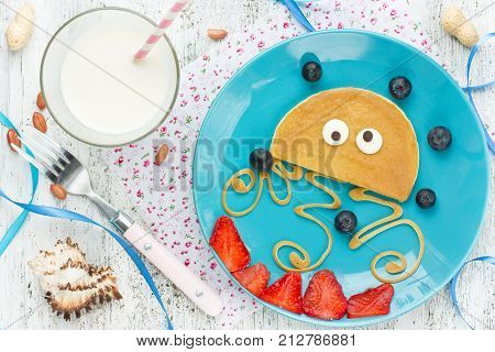 Fun and healthy breakfast idea for kids - pancake shaped medusa with peanut butter and fresh berries poster