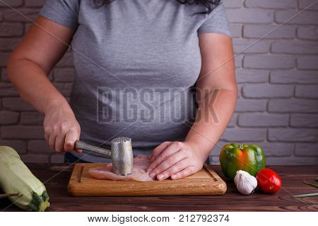 Overweight Woman Hands Beating Chicken Breasts With Meat Hammer, Close Up. Dieting, Healthy Low Calo