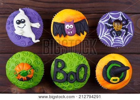 Tasty Halloween Cupcakes Set With Colorful Decorations: Pumpkin, Ghost, Spider, The Word
