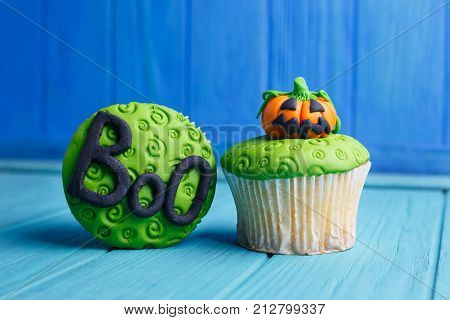 Halloween Party Sweets. Delicious Halloween Cupcakes With Pumpkin And Word Boo Decorations Made Of C