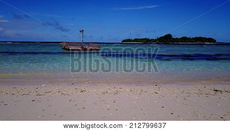 pontoon in maldives white sand beach tropical islands with drone aerial flying with aqua blue sea water and sunny sky