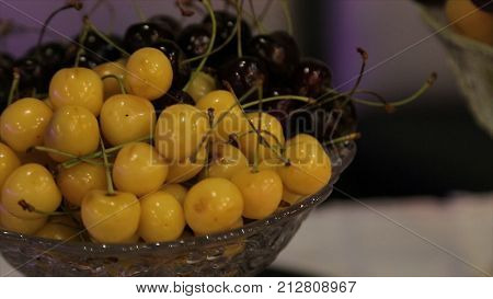 Different fresh fruits on wedding buffet table. Fruits and berries Wedding table decoration. Buffet reception fruit wines champagne. Wedding table decoration. Cherry HD