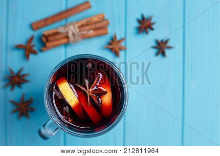 Mulled Wine, Spices And Food Decorations On Bright Background, Top View. Hot Drinks, Warming Up, Win