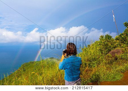 Lady Try To Catch The Rainbow On Pha Hin Dum Viewpoint