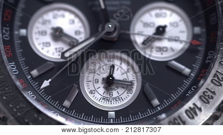 Extreme macro detail of swiss made watch shot with macro lens luxury male accessory for business. Detail of a luxury watch on black background. Selective focus, shallow depth of field. a macro shot of an automatic winding watch. Clock HD