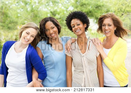 Diverse group of friends standing outside, Woman only.