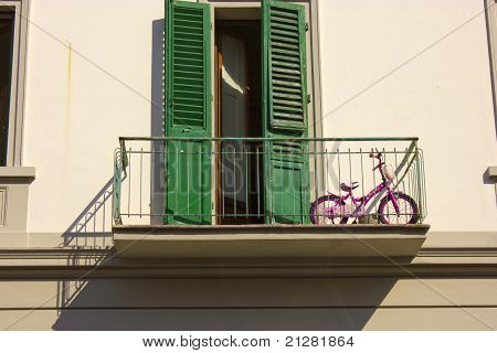 Pink children bike on a balcony