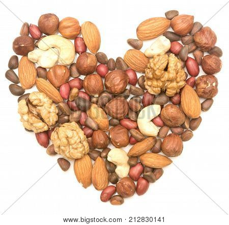 mixed nuts in the shape of the heart on white background