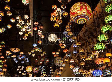 Multicolored oriental lamps hanged from the ceiling/ Lighted glass tile lamps hanged / Colored mosaic lamps hanging from ceiling