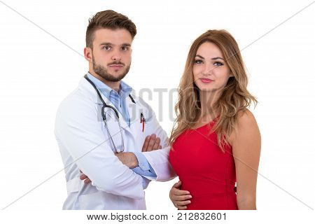 Smiling young doctor reassuring woman patient about medical results. Isolated on white