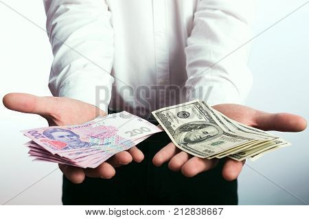 Businessman with hryvnia in his hands and dollars
