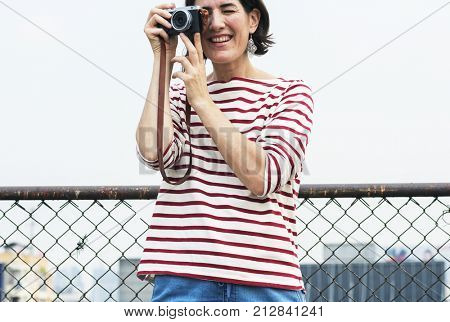 An Adult Woman With Camera Capturing Snapshots Outdoor
