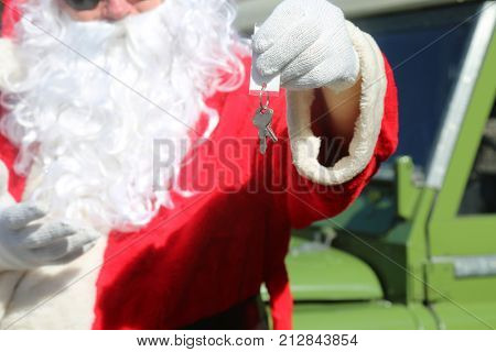 Santa Claus drives his car. Santa Claus hands you the keys to your New Car.