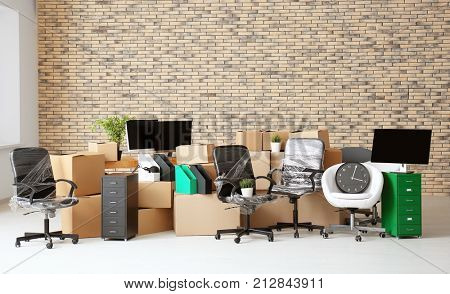 Carton boxes with stuff in empty room. Office move concept
