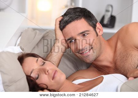 a man looking a wife sleeping deeply
