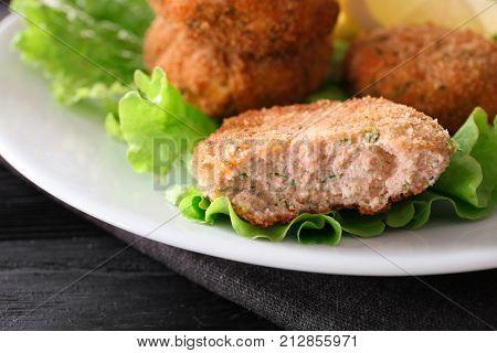 Plate with tasty salmon patties, closeup