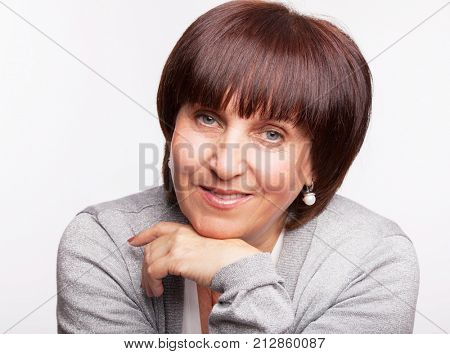 Smiling woman 50 years old. Happy female. Studio shot