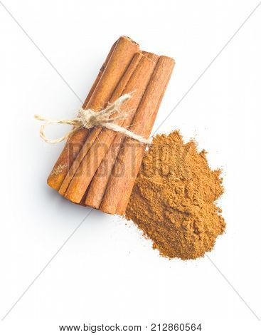 Cinnamon sticks and milled cinnamon isolated on white background.
