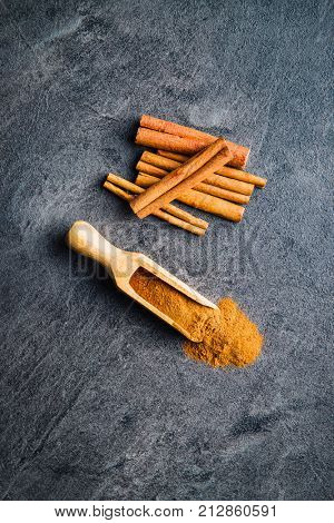 Cinnamon sticks spice and milled cinnamon. Top view.