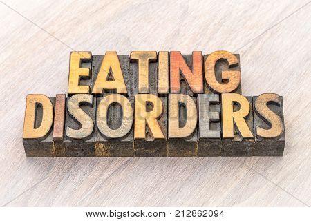 eating disorders word abstract in vintage letterpress wood type printing blocks