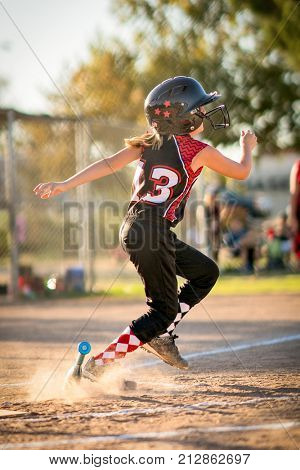 Running child playing baseball or softball