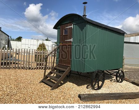 Old movable shepherds hut on gravel. The hut on wheels could be moved on a daily basis to accommodate the shepherd when he moved sheep to new pasture.
