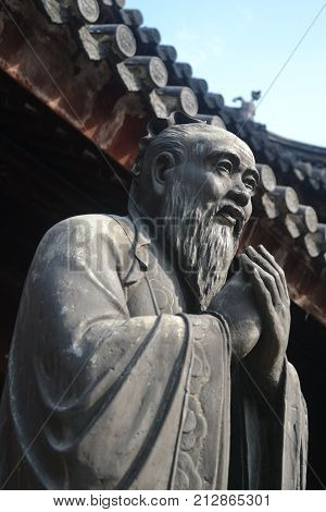 A statue of the legendary Confucius in Shanghai, China. poster