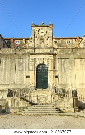 DUBROVNIK CROATIA - JULY 22 2017 : A view of the entrance to the Bishopric Classical Grammar School Ruder Boskovic in Dubrovnik Croatia.