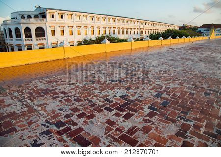 View of the red bricks that form the floor of the colonial era wall in Cartagena Colombia. poster