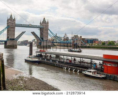 Tower Bridge drawn open on the River Thames, London, England