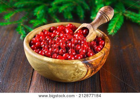 Cowberry, Foxberry, Cranberry, Lingonberry In A Wooden Bowl With A Scoop On A Brown Wooden Table. Su
