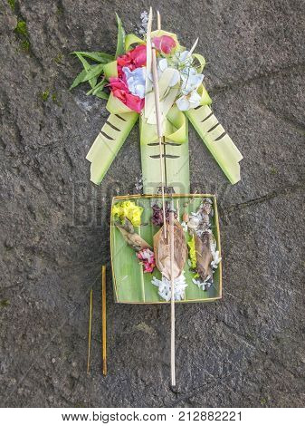 sacrifice object on stony ground seen in Bali Indonesia