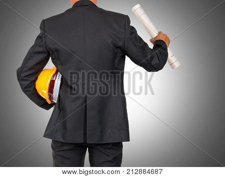engineer in suit holding orange helmet and blueprint for workers security on white background include clipping path industrial concept