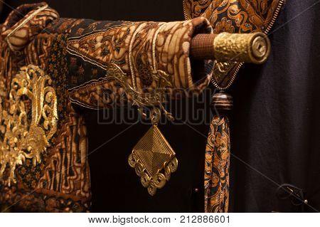 extravagant costume east asia, village, rustic decor, traditional clothes in batik