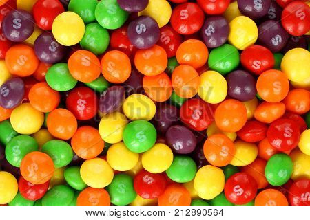 Kiev Ukraine - September 22 2017: Skittles multicolored fruit candies background. Skittles is a brand of fruit-flavoured sweets currently produced and marketed by the Wrigley Company