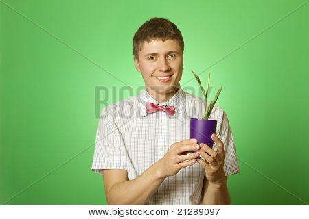 Man Observes Cultivation Of Young Plants