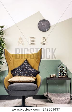Living room interior with armchair and pillows