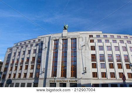 Prague Czech Republic - May 10 2017: Statue on roof of entrance to the bank Czech National Bank.The Czech National Bank is the central bank and financial market supervisor in the Czech Republic with its headquarters in Prague