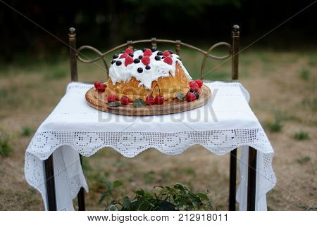 Strawberry cake Frazier on a wooden background with mint leaves