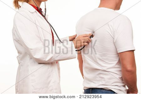 Female Doctor With A Medical Stethoscope, Listening A Patient Heartbeat