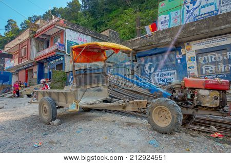 BHAKTAPUR, NEPAL - NOVEMBER 04, 2017: Unidentified people walking close to a small truck parked in a small town, Valley, Nepal.