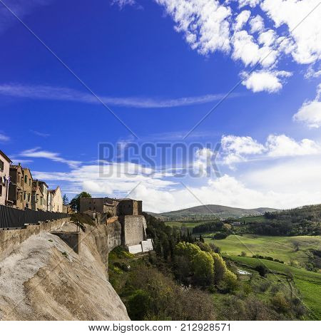 Village Trevinano located upon a hill near the borders of Lazio with the Tuscany and Umbria. Italian landscape with forests and meadow early in the morning. Agriculture in Italy fields and pastures.