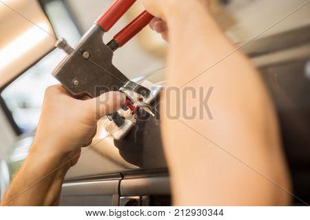 A professionel repairing dents in a car