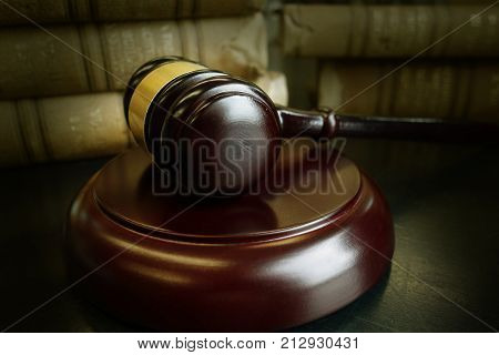 Judge's legal gavel and old law books