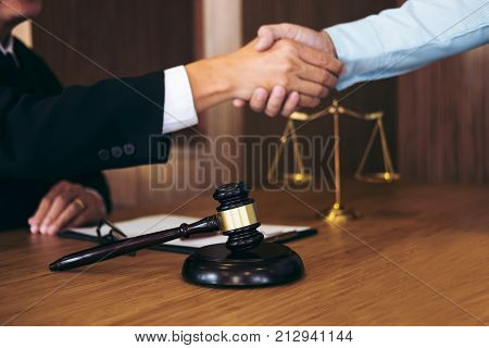 Handshake after good cooperation Consultation between a male lawyer and businessman customer tax and the company of real estate concept.