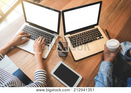 Two businessmen at work Business crew working with new startup financial project planman and woman discussion information with laptop and digital tablet in a modern business loungeSelective Focus.