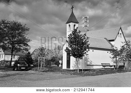 Okna, Litomerice District, Czech Republic - October 13, 2017: Small Chapel In Autumnal Village Green