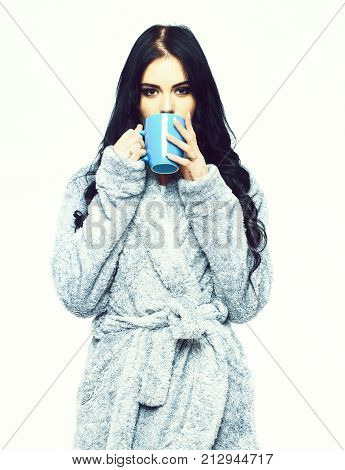 Sexy Girl Posing In Blue Velour Bathrobe With Cup
