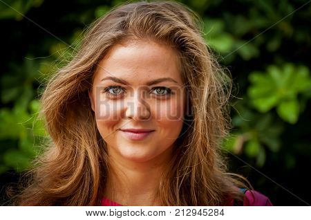Young and attractive Caucasian girl with a mild smile, positive character, optimistic person.