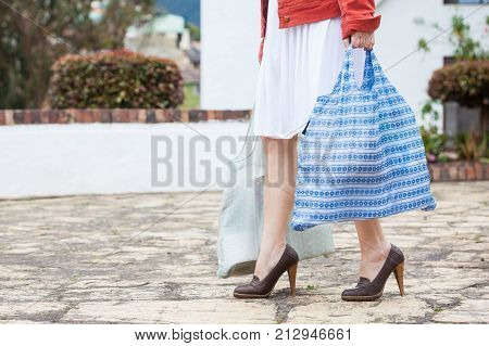Woman Carrying Groceries In A Reusable Shopping Bag
